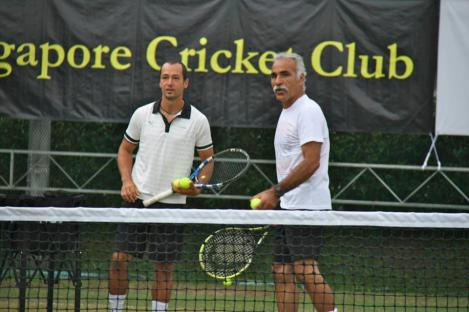 The world famous Mansour Bahrami and me in a heated doubles match.